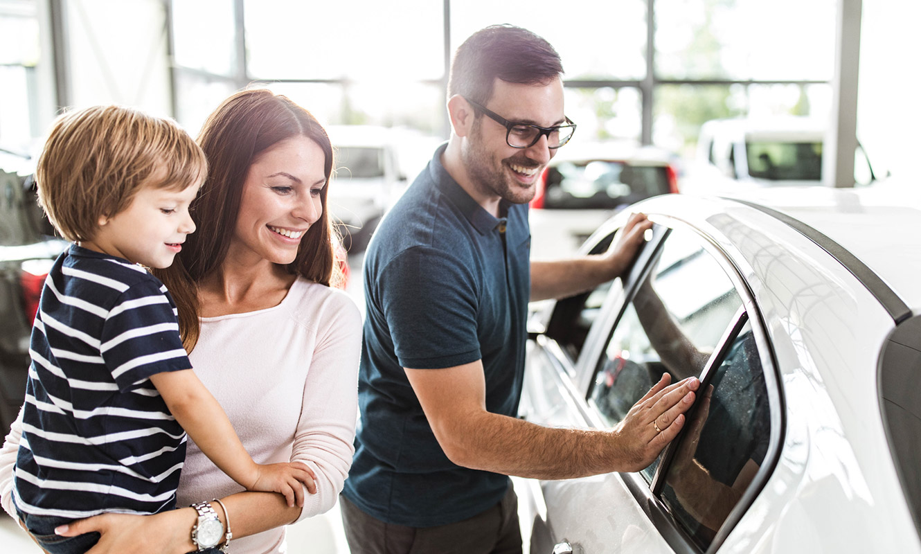 Young family buying new car